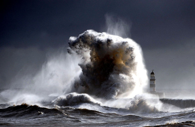 """Raging sea's Seaham 2"". A raging sea Dwarfs Seaham Lighthouse in County Durham in England, with 100ft waves after a cold front moved down from the north bringing freezing temperatures to the North of England. (Photo and caption by Owen Humphreys/National Geographic Traveler Photo Contest)"