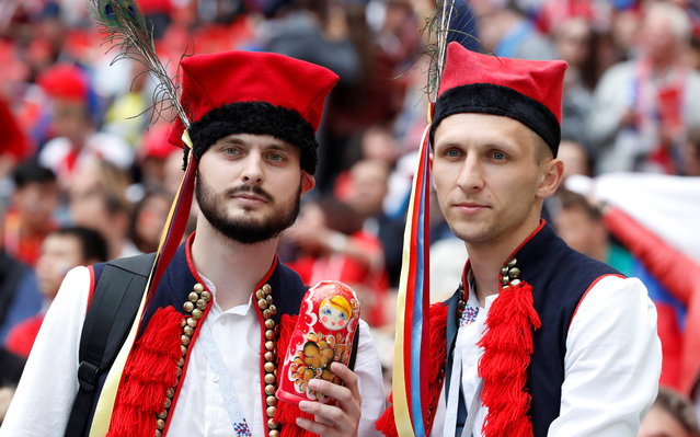 Russia fans pose before the Russia 2018 World Cup Group A football match between Russia and Saudi Arabia at the Luzhniki Stadium in Moscow on June 14, 2018. (Photo by Christian Hartmann/Reuters)