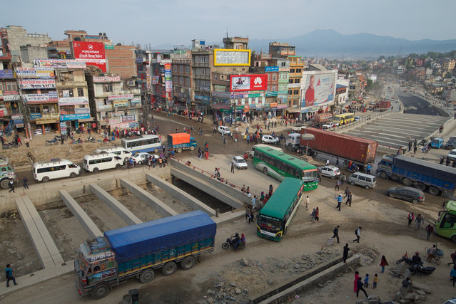 The construction of the city's first underpass at Kalanki is both a source of pride and frustration. Vehicles can wait for an hour to pass through the junction. (Photo by Pete Pattisson/The Guardian)