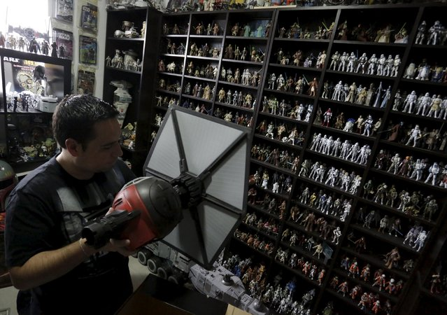 Mexican collector Pablo Perez, displays a toy collection of Star Wars characters and items at his home in Monterrey, Mexico December 12, 2015. (Photo by Daniel Becerril/Reuters)