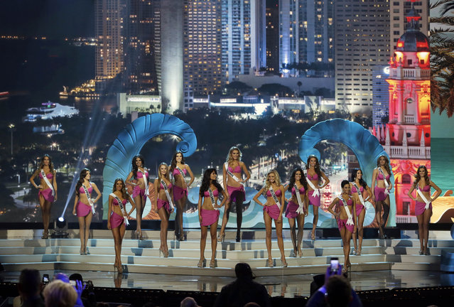 The 15 top finalist contestants pose during the Miss Universe pageant in Miami, Sunday, January 25, 2015. (Photo by Wilfredo Lee/AP Photo)