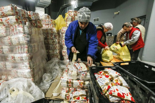 Workers from Rinat Akhmetov's Foundation sort humanitarian aid at Donbass Arena stadium in Donetsk February 3, 2015. (Photo by Maxim Shemetov/Reuters)