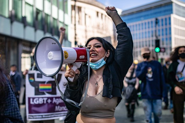 """A woman shouting into a megaphone during a """"Kill the Bill"""" protest in Manchester City Centre on April 3, 2021 in Manchester, United Kingdom. Protests around the United Kingdom have been held in opposition to the Police, Crime, Sentencing and Courts Bill. The proposed legislation, which would apply to England and Wales, covers a wide range of issues and would broaden the police's authority for regulating protests. (Photo by Mercury Press and Media)"""