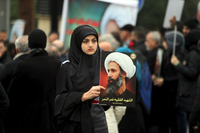 "A girl carries a picture of Sheikh Nimr al-Nimr, who was executed along with others in Saudi Arabia, during a protest against the execution in front of the United Nation's building in Beirut, Lebanon January 3, 2016.  Sign reads, ""The martyr scholar Nimr al-Nimr"". (Photo by Hasan Shaaban/Reuters)"
