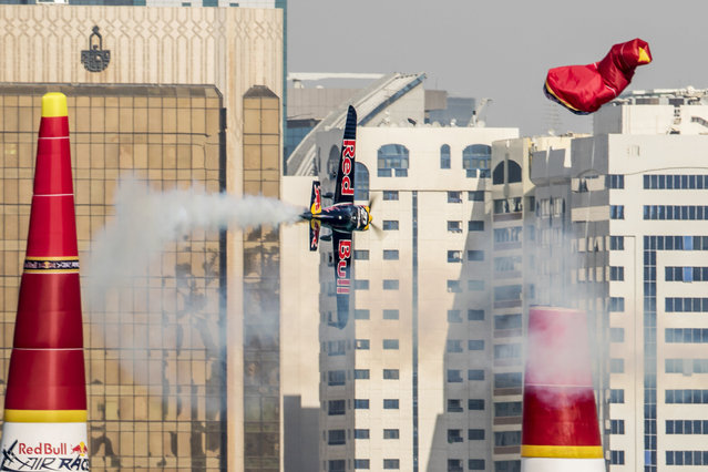 In this photo provided by Andreas Langreiter via Global-Newsroom, Peter Besenyei of Hungary performs during the qualifying of the first stage of the Red Bull Air Race World Championship in Abu Dhabi, United Arab Emirates, Friday, February 13, 2015. (Photo by Andreas Langreiter/AP Photo/Global-Newsroom)
