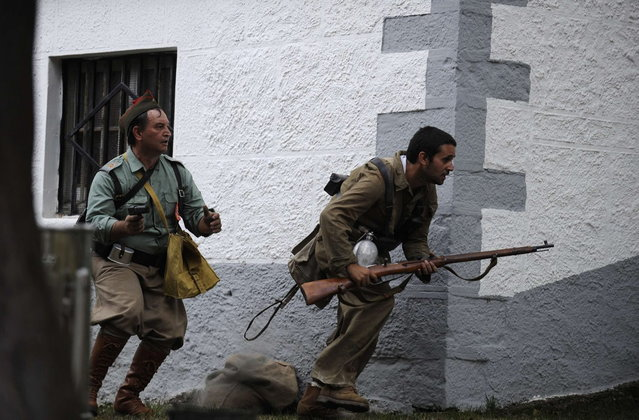 """Actors take part in a re-enactment of the """"Battle of Areces"""" that took place during the Spanish Civil War, in Grullos, north of Spain, September 14, 2013. The re-enactment of the historic 1937 battle was organised by the Frente del Nalon Association. (Photo by Eloy Alonso/Reuters)"""