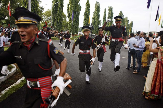 Cadets celebrate after a graduation ceremony at Officers Training Academy in Chennai, India, on September 14, 2013. A total of 350 cadets graduated and will be posted as Lieutenants in the Indian Army. (Photo by Arun Sankar K./Associated Press)