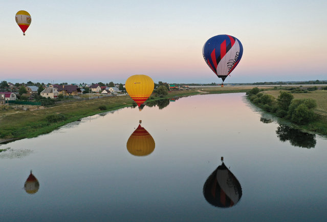 Hot-air balloons launched by participants in the 2020 Sky of Russia International Balloon Festival in Ryazan Region, Russia on August 17, 2020. (Photo by Alexander Ryumin/TASS)
