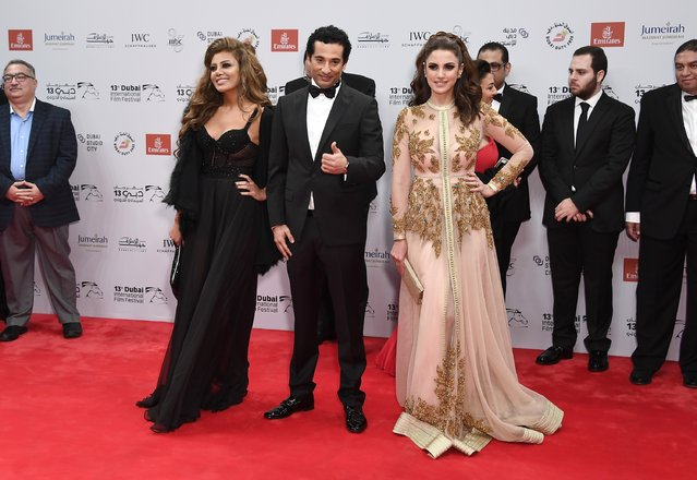 """Actors Reham Haggag, Amr Saad and Dorra attend """"The Preacher"""" red carpet during day four of the 13th annual Dubai International Film Festival held at the Madinat Jumeriah Complex on December 10, 2016 in Dubai, United Arab Emirates. (Photo by Gareth Cattermole/Getty Images for DIFF)"""