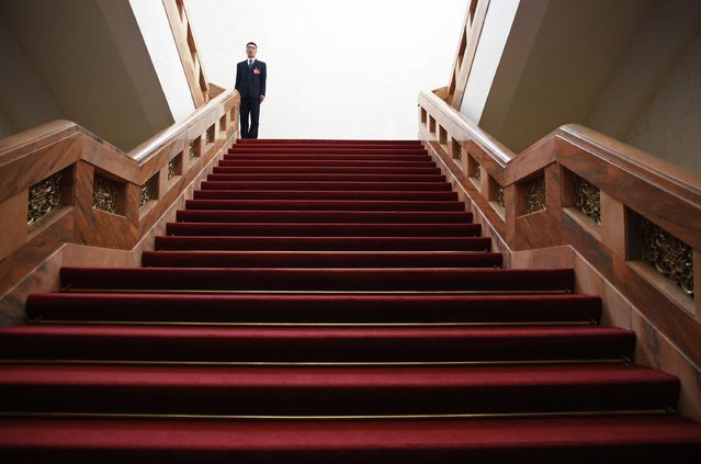 A security officer stands guard inside the Great Hall of the People during the opening session of the Chinese People's Political Consultative Conference (CPPCC) in Beijing, March 3, 2015.  REUTERS/Kim Kyung-Hoon