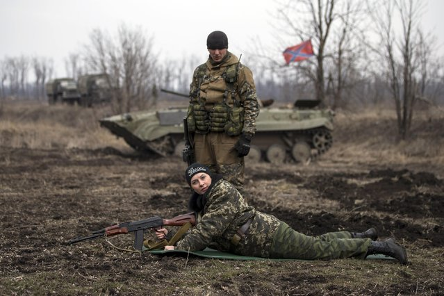 A pro-Russian rebel takes part in shooting training in the village of Chornukhyne near the town of Debaltseve, north-east from Donetsk, March 12, 2015. (Photo by Marko Djurica/Reuters)