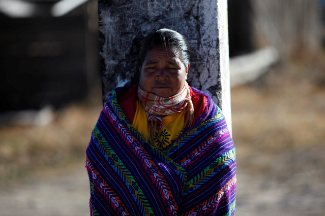 A woman from the Tarahumara ethnic group receives the heat of the sun on her face as they prepare for winter in Caborachi village, in Guachochi, Mexico, December 17, 2016. (Photo by Jose Luis Gonzalez/Reuters)