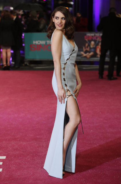 """U.S. actress Alison Brie poses for photographers at the European premiere of the film """"How to be Single"""" in London, Britain February 9, 2016. (Photo by Neil Hall/Reuters)"""