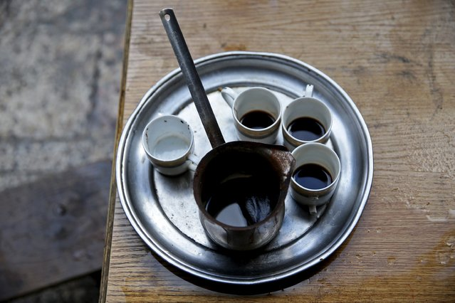 Cups of coffee stand inside Shahrour's home in the besieged town of Arbeen, in Damascus suburbs, Syria February 6, 2016. (Photo by Bassam Khabieh/Reuters)