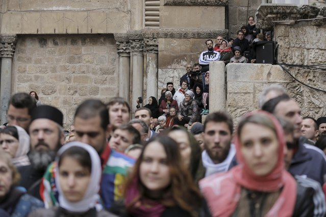 People participate in the washing of the feet ceremony outside the Church of the Holy Sepulchre in Jerusalem's Old City, April 9, 2015, ahead of Orthodox Easter. (Photo by Ammar Awad/Reuters)