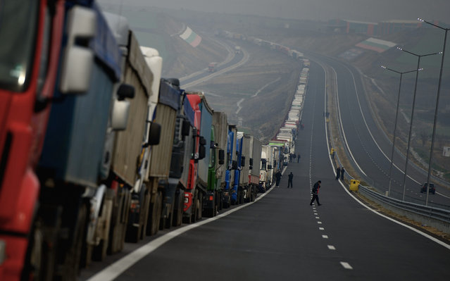 Trucks queue at the Bulgarian border point with Greece in Kulata some 180 km from Sofia, Bulgaria, 17 February 2016. All three crossing points on the Bulgarian-Greek border were closed of the ongoing protests of Greek farmers, as then Bulgarian drivers in response, blocked the Bulgarian side of the border with Greece. (Photo by Vassil Donev/EPA)