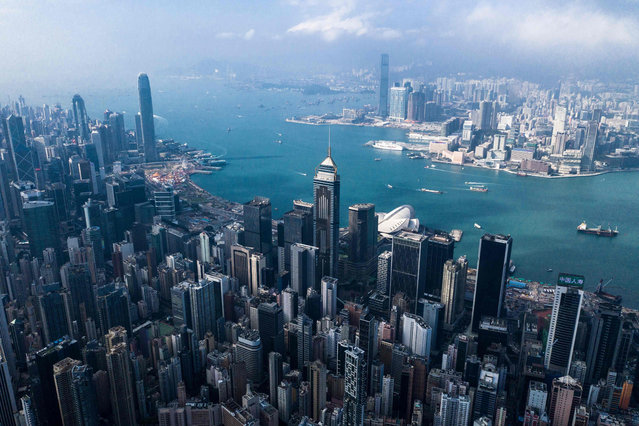 This aerial photo taken on December 19, 2018 shows a general view of the skyline of Hong Kong. (Photo by Dale De La Rey/AFP Photo)