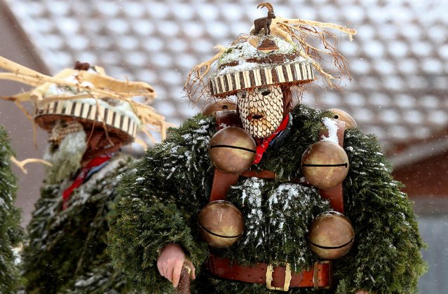 """Men dressed as """"Chlaeuse"""", figures that scare away evil spirits, carry round bells and cowbells are seen during the traditional """"Sylvesterchlausen"""" near the northeastern village of Urnaesch, Switzerland January 13, 2017. (Photo by Arnd Wiegmann/Reuters)"""