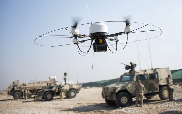 A Mikado drone of the Bundeswehr flies during a show of German soldiers at Camp Marmal in Mazar-e-Sharif on December 23, 2013. About 3,000 German troops are deployed in Afghanistan, where the country is the lead nation in the relatively peaceful northern region. (Photo by Johannes Eisele/AFP Photo)