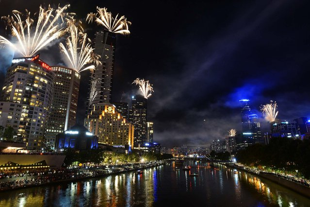 Fireworks explode over the Melbourne, Australia skyline and Yarra River. (Photo by Vince Caligiuri/Getty Images)