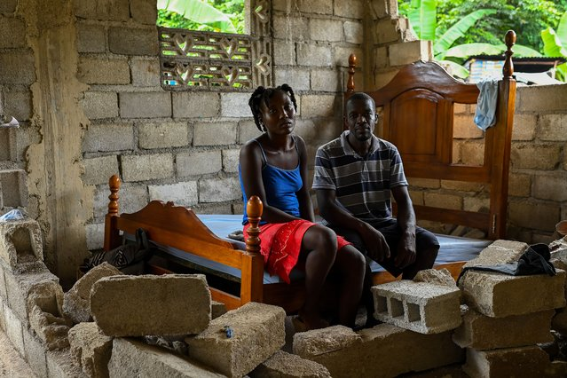 Pierre Fortuis and his wife Josianne Charles who was affected by the recent earthquake poses for a portrait inside their damaged home on August 21, 2021 in Maniche, Haiti. (Photo by Joshua Lott/The Washington Post)