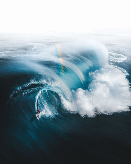 Gold at the End of the Rainbow. Sport Winner. A surfer, Ollie Henry, escapes a monster wave off the coast of South West Western Australia. (Photo by Phil De Glanville/Drone Photography Awards 2021)