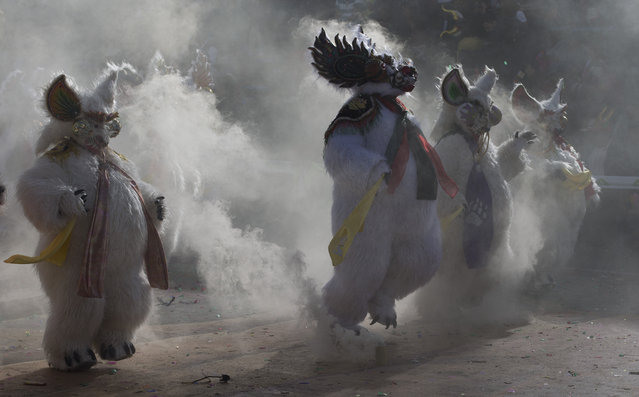 """Dancers perform the traditional """"Diablada"""", or Dance of the Devils, during carnival celebrations in Oruro, Bolivia, Saturday, March 2, 2019. The festival features folk dances, costumes, crafts, music and up to 20 hours of continuous partying. (Photo by Juan Karita/AP Photo)"""