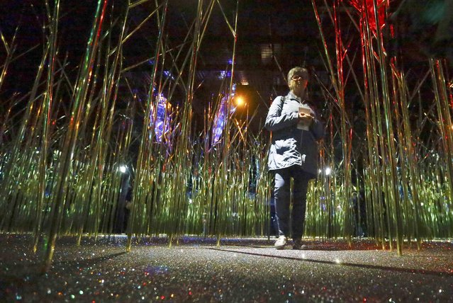 A visitor walks through the Swarowski Crystal World museum on its reopening day following renovation, in the western Austrian village of Wattens April 30, 2015. (Photo by Dominic Ebenbichler/Reuters)