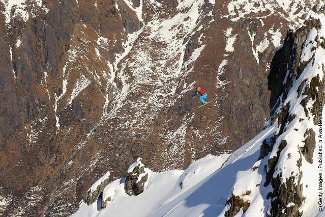 Freeskier Sam Foster of Australia launches off a drop during the World Heli Challenge freestyle day in backcountry at Minaret Station on July 31, 2011 in Wanaka, New Zealand