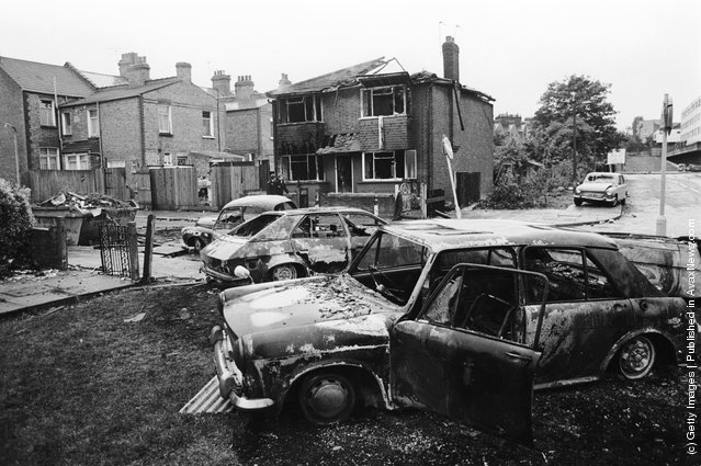 A burned-out house and cars on the Broadwater Farm housing estate, Tottenham, London, the day after the riot of 6th October 1985