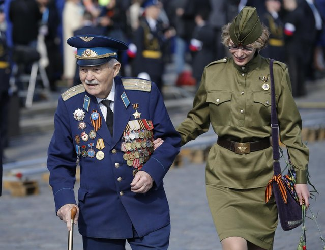 An unidentified Russian veteran of WWII walks in Red Square before the Victory Parade, celebrating 70 years after the victory of the war, in Moscow, Russia, Saturday, May 9, 2015. (Photo by Alexander Zemlianichenko/AP Photo)