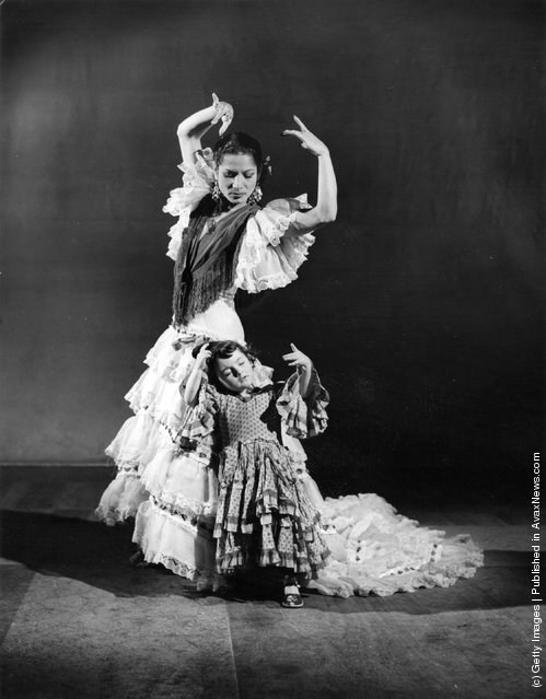 Flamenco dancer Carmen Amaya with a very young dancer
