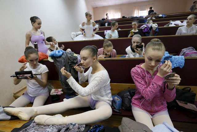 Students of the Krasnoyarsk choreographic college prepare backstage before a dress rehearsal of a performance by graduates of the college at the State Theatre of Opera and Ballet in Russia's Siberian city of Krasnoyarsk, Russia, May 12, 2015. (Photo by Ilya Naymushin/Reuters)