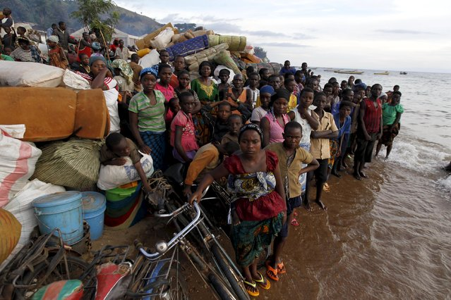 Burundian refugees gather on the shores of Lake Tanganyika in Kagunga village in Kigoma region in western Tanzania with their belongings, as they wait for MV Liemba to transport them to Kigoma township, May 17, 2015. (Photo by Thomas Mukoya/Reuters)
