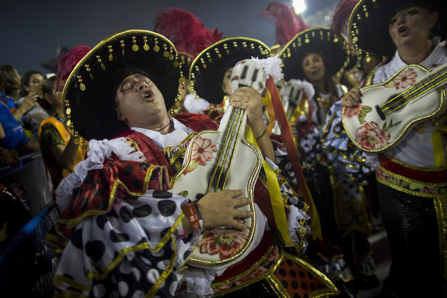 A performer from the Academicos do Grande Rio samba school parades during Carnival celebrations at the Sambadrome in Rio de Janeiro, Brazil, Monday, February 27, 2017. (Photo by Mauro Pimentel/AP Photo)