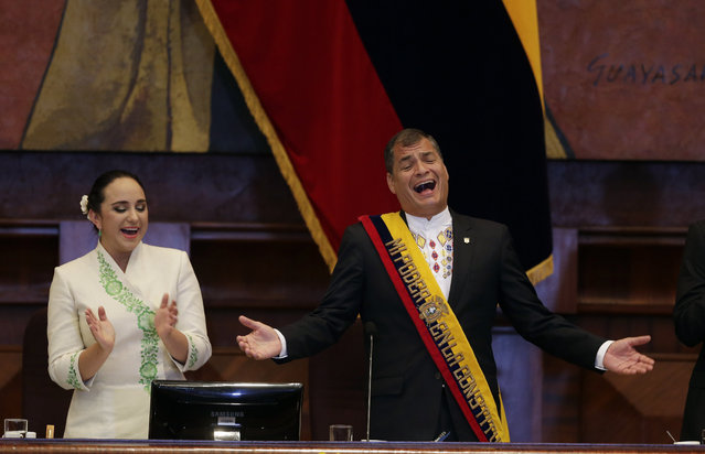 Ecuador's President Rafael Correa, right, and the President of the National Assembly Gabriela Rivadeneira sing before the ceremony to present the report on the state of the nation at National Assembly in Quito, Ecuador, Sunday, May 24, 2015. (Photo by Dolores Ochoa/AP Photo)