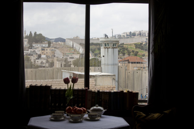"An Israeli security watch tower is seen from one of the rooms of the ""The Walled Off Hotel"" in the West Bank city of Bethlehem, Friday, March 3, 2017. (Photo by Dusan Vranic/AP Photo)"