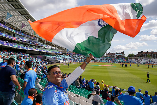 An India fan waves a flag before the Group Stage match of the ICC Cricket World Cup 2019 between India and Australia at The Oval on June 9, 2019 in London, England. (Photo by Henry Browne/Getty Images)