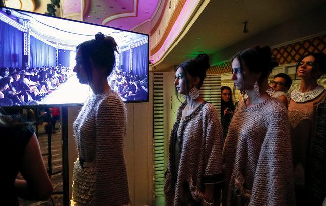 Models wait for a show backstage during Kazakhstan Fashion Week in Almaty, Kazakhstan, April 21, 2016. (Photo by Shamil Zhumatov/Reuters)