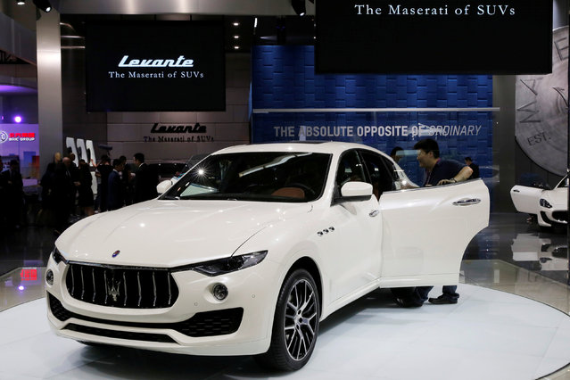 A visitor takes a look around a Maserati's SUV model Levante during the Auto China 2016 show in Beijing, China April 25, 2016. (Photo by Kim Kyung-Hoon/Reuters)