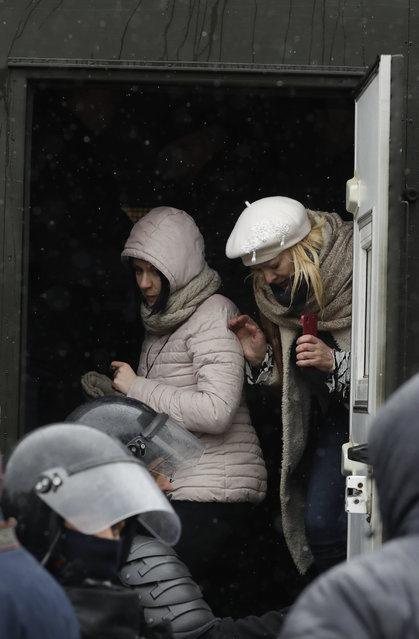 Two women are detained by police during an opposition rally in Minsk, Belarus, Saturday, March 25, 2017. (Photo by Sergei Grits/AP Photo)