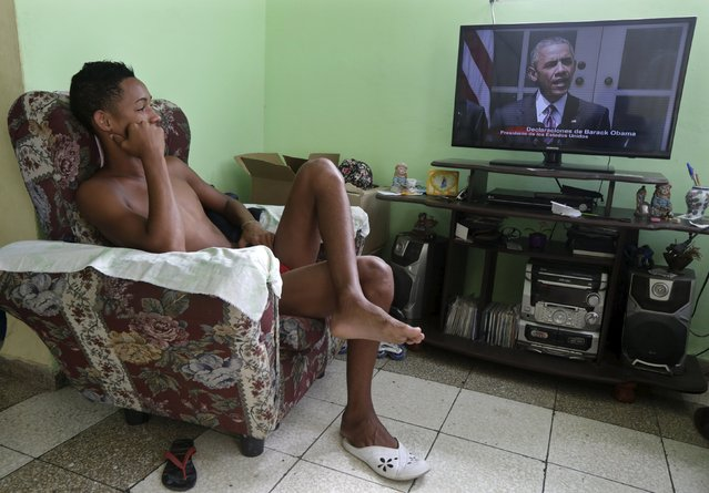 A man watches a television broadcast of U.S. President Barack Obama speaking, in Havana, Cuba July 1, 2015. Obama said on Wednesday the United States has agreed to the historic step of re-establishing diplomatic relations with Cuba, and will raise its flag over a U.S. Embassy in Havana this summer. (Photo by Enrique de la Osa/Reuters)