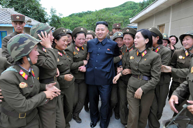 This undated photo released by North Korea's official Korean Central News Agency (KCNA) via the Korean News Service (KNS) on August 24, 2012 shows North Korean leader Kim Jong Un (C) inspecting the Thrice Three-Revolution Red Flag Kamnamu Company under Korean People's Army Unit 4302 at an undisclosed location in North Korea. (Photo by AFP Photo/KCNA via KNS)
