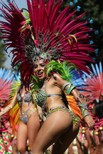Performers in costume take part in the carnival on the main Parade day of the Notting Hill Carnival in west London on August 26, 2019. Nearly one million people were expected by the organisers Sunday and Monday in the streets of west London's Notting Hill to celebrate Caribbean culture at a carnival considered the largest street demonstration in Europe. (Photo by Daniel Leal-Olivas/AFP Photo)