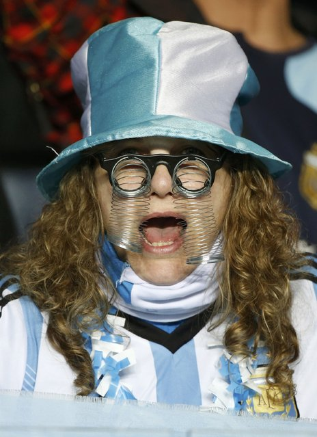 An Argentina fan cheers as she awaits the start of the team's Copa America 2015 semi-final soccer match against Paraguay at Estadio Municipal Alcaldesa Ester Roa Rebolledo in Concepcion, Chile, June 30, 2015. (Photo by Carlos Garcia Rawlins/Reuters)