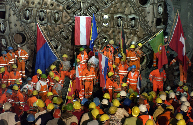 In this September 6, 2006 file photo miners celebrate a breakthrough in the NEAT Gotthard base tunnel in Faido, Switzerland. The celebrations of the opening of the NEAT Gotthard Base Tunnel will start on June 1, 2016. (Photo by Karl Mathis/Keystone via AP Photo)