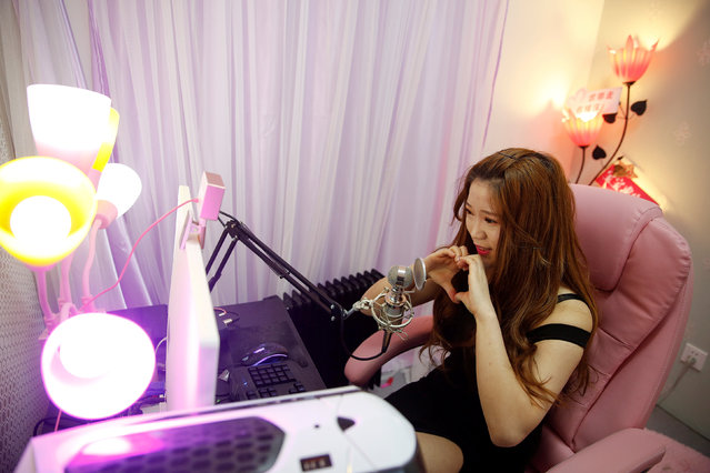 A girl broadcasts at live streaming talent agency Three Minute TV in Beijing, China, February 11, 2017. (Photo by Damir Sagolj/Reuters)