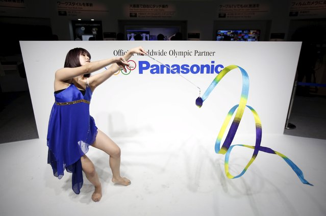 A woman performs rhythmic gymnastics with a ribbon at the Panasonic Corp booth at the Combined Exhibition of Advanced Technologies (CEATEC) JAPAN 2014 in Chiba, east of Tokyo, in this October 7, 2014 file photo. Panasonic is expected to release Q1 results this week. (Photo by Issei Kato/Reuters)