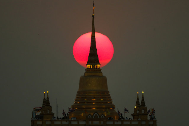 The sun sets behind Wat Saket Temple, or Golden Mount in Bangkok, Thailand, March 11, 2019. (Photo by Athit Perawongmetha/Reuters)