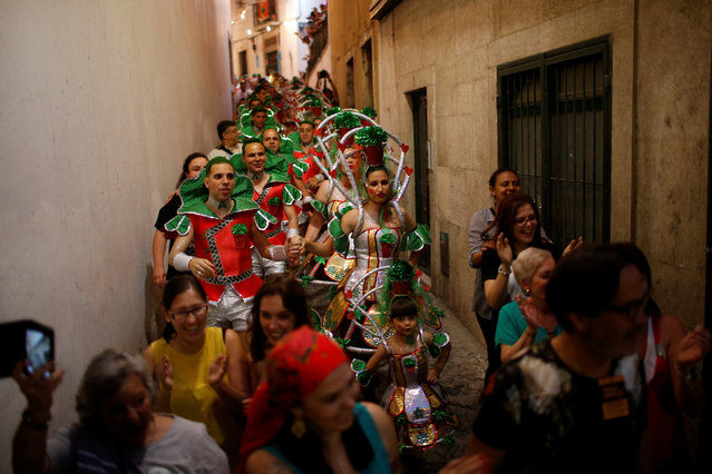 Members of Alfama's group walk down a street on their way to the Saint Anthony's Parade in Lisbon, Portugal June 12, 2016. (Photo by Rafael Marchante/Reuters)